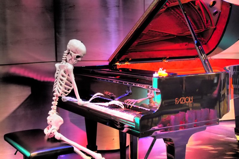 Photo of skeleton playing piano
